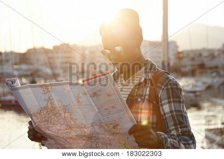 People, Lifestyle, Traveling And Adventures Concept. Outdoor Portrait Of African Male Tourist In Che