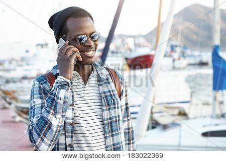 Close Up Portrait Of Attractive And Charismatic Dark-skinned Guy In Stylish Cap And Fashionable Oval