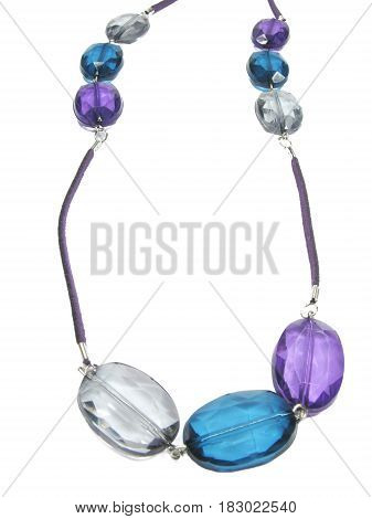 colored jewellery with blue green and grey crystals on violet lace