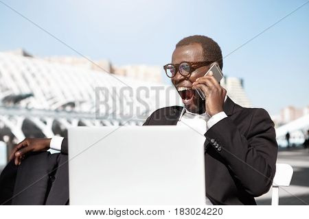 Tired Yawning Young Afro American Banker Dressed Formally Sitting At Outdoor Cafe Table In Front Of