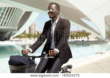 Happy Environmentally Conscious African American Employee Wearing Black Formal Suit And Sunglasses C
