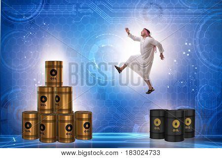 Arab businessman jumping from oil barrels