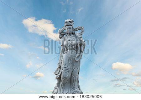 Guan Yin statue stone god of china on sky background