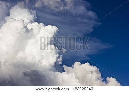 big cumulus clouds on sky at sunset before storm