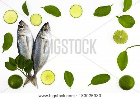 Selar crumenophthalmus Bigeye scad fish with lemon and leaf isolated on white backgroundconcept cooking background