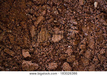 Ground coffee closeup. Shallow depth of field.
