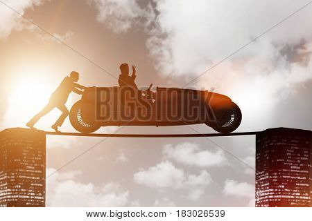Teamwork concept with businessman pushing car