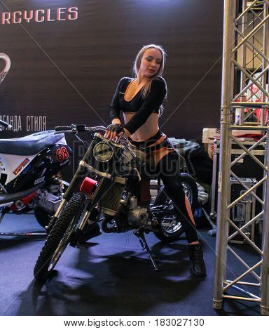 St. Petersburg Russia - 15 April, Young girl on a motorcycle,15 April, 2017. International Motor Show IMIS-2017 in Expoforurum. Models on motorcycles presented at the motor show.