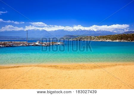 Beach at Marathi bay and the White Mountains on Crete, Greece