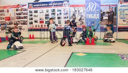 St. Petersburg Russia - 15 April, A platform for young visitors to the moto salon,15 April, 2017. International Motor Show IMIS-2017 in Expoforurum. Visitors and participants of the annual moto-salon in St. Petersburg.