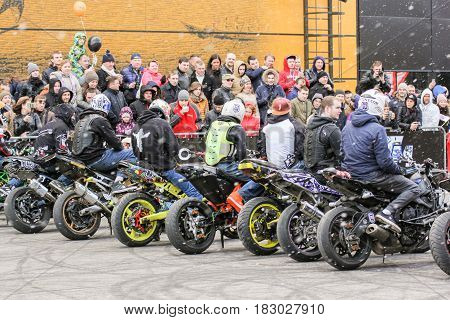 St. Petersburg Russia - 15 April, Bikers under the snow,15 April, 2017. International Motor Show IMIS-2017 in Expoforurum. Sports motorcycle show of bikers on the open area.