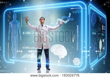 Doctor in futuristic medical concept pressing button