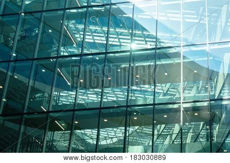 Glass wall of mordern office building as background