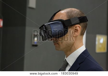 Man Trying Virtual Reality Headset At Technology Hub