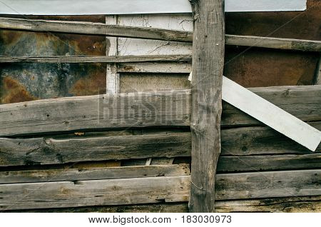 Aged wooden fence background. Old countryside rustic wood metal fence.
