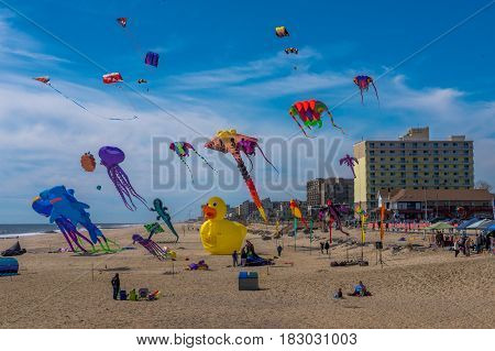 Long Branch NJ -- April 23 2017 -- People fly kites on the beach at the annual Kites at the Pier Festival. Editorial and Illustrative. Editorial Use Only.