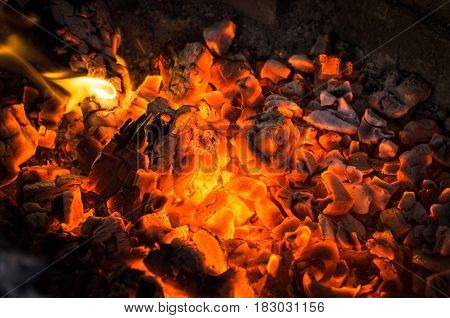 Burning coals close up. Fire and embers background.