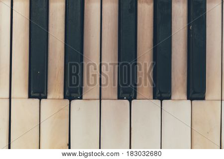Antique vintage piano keyboard, top view, close up photo, toned