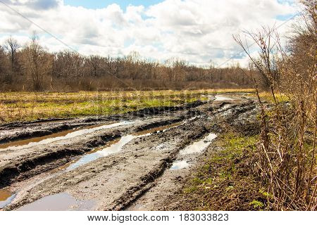 Spring landscape. Dirty spring road. Impassibility and mudslides