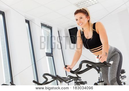 Attractive young woman during. Cardio and fatburning. Fitness concept.