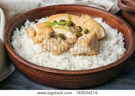 Bowl with tasty chicken and rice, closeup