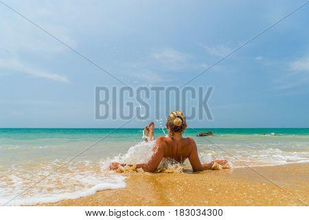Beautiful Woman sitting on the beach in Khao Lak  Thailand