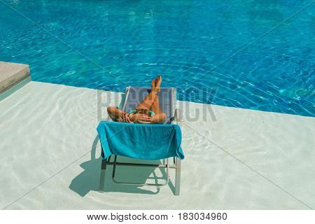 Woman at the swimming pool