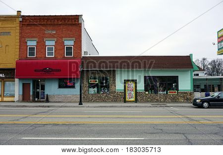 KALKASKA, MICHIGAN / UNITED STATES - NOVEMBER 27, 2016: Some of the principal businesses on Cedar Street in downtown Kalkaska include the Kal-Ho Lounge and a gun shop.