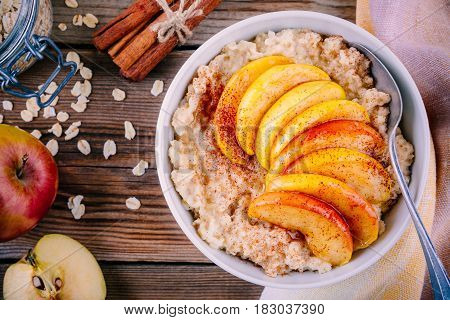 Healthy Breakfast: Oatmeal Bowl With Caramelized Peaches, Cinnamon And Honey