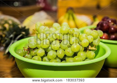 Fresh green grapes on a wooden table.