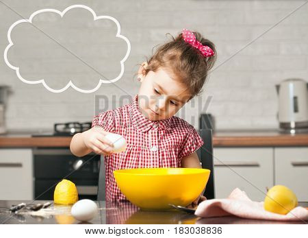 cute little girl baker on kitchen with baking ingredients tasty
