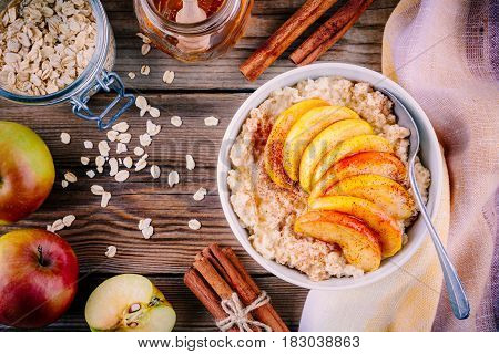 Healthy Breakfast: Oatmeal Bowl With Caramelized Apples, Cinnamon And Honey