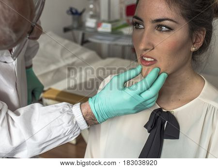 expert doctor visiting a young girl for headache and toothache