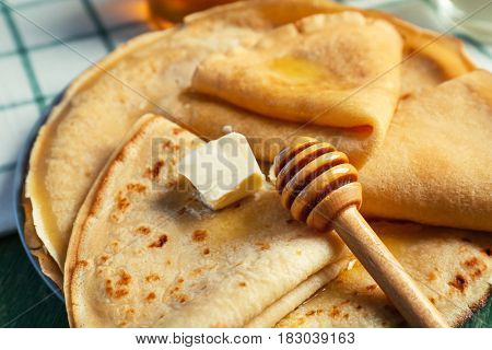 Plate with delicious pancakes on table