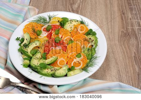 Salad citrus fennel and avocado with shallots and mint leaves