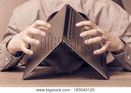 Stressed Businessman Covering His Head With His Laptop, Toning. Burn Out At Work Concept.