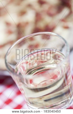 closeup of white wine and flammkuchen on the table