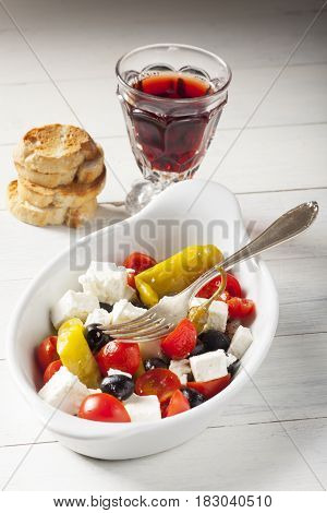 greek salad with feta cheese and red wine