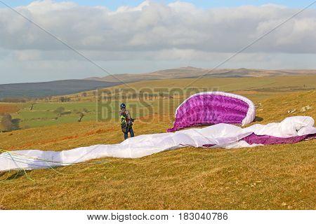 Paragliders preparing their wings on Dartmoor, Devon