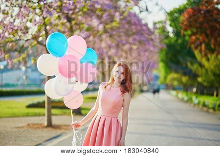 Young Woman In Pink Dress With Bunch Of Balloons In Paris