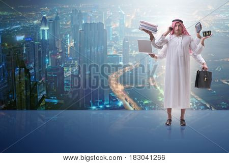 Arab businessman in multitasking concept