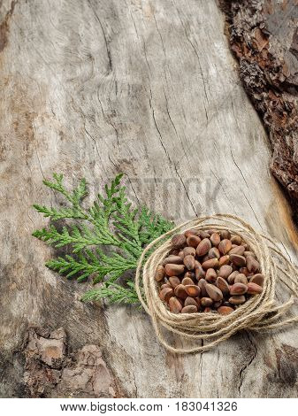 Unshelled Pine Nuts On Aged Wood