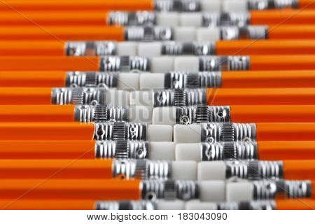 Background of yellow pencils with the erasers