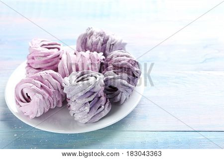 Sweet Zephyr In Plate On Blue Wooden Table