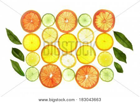 Slices of citrus fruits on white background