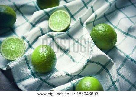 Simple composition with juicy limes on table
