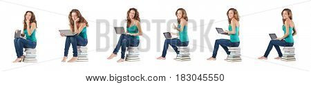Student with netbook sitting on books