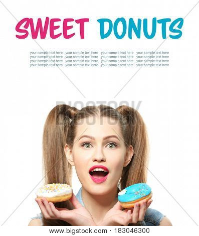 Young woman with tasty donuts on white background