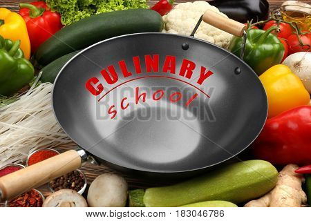 Culinary school concept. Wok pan with vegetables, closeup