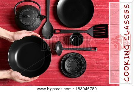 Cooking classes concept. Female hands and dishware on red wooden background